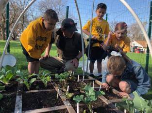 "Growing Minds. The Good Shepherd ""Lil' Acre"" garden, located on the west end of campus, offers students a unique, hands-on environmental learning experience."
